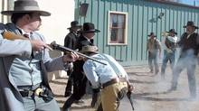 <137>An Actor portraying Doc Holliday backs up actors portraying the Earp brothers with his shotgun during a reenactment of the historic Gunfight at the O.K. Corral on the in Tombstone, Ariz., on Thursday, Oct. 26, 2006. Wyatt Earp, who, with brothers Virgil and Morgan and comrade Doc Holliday, made history in the gunfight at the O.K. Corral on Oct. 26, 1881. When the 30-second fight was over, three of their adversaries Frank and Tom McLaury and Billy Clanton lay dead. (AP Photo/Sierra Vista Herald, Mark Levy)<252><137>The 1881 Gunfight at the O.K. Corral<137>, which is re-enacted for tourists in Tombstone, Ariz.,<137> is an example of how misunderstandings can get out of hand. Bear that in mind when dealing with customers, advises author John Golden. (MARK LEVY/AP)