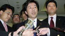 Japan'ese Finance Minister Jun Azumi, centre, speaks to media at the Finance Ministry in Tokyo on Oct. 31, 2011. (KYODO/KYODO/REUTERS)