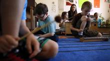 Students learn to play the xylophone during Miss Amanda's class at the ArtsCalibre Academy in Victoria. (CHAD HIPOLITO FOR THE GLOBE AND MAIL)