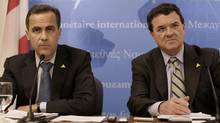 Instead of lecturing home buyers, Bank of Canada Governor Mark Carney, left, and federal Finance Minister Jim Flaherty should take a long hard look at what's happening in the financial services industry. (Yuri Gripas/Reuters/Yuri Gripas/Reuters)