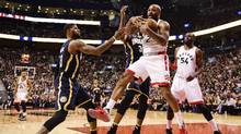 Toronto Raptors forward P.J. Tucker (2) grabs a rebound in front of Indiana Pacers forward Paul George (13) and Pacers centre Myles Turner (33) as Raptors forward Patrick Patterson (54) looks on during second half NBA basketball action, in Toronto on Sunday, March 19, 2017. (Frank Gunn/THE CANADIAN PRESS)