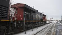 A CN train passes by Dorval station in Montreal on Jan. 23, 2012. (Christinne Muschi for The Globe and Mail)
