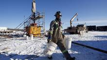 The wellhead at a hydraulic fracturing operation near Bowden, Alta., Feb. 14, 2012. Finding, developing and producing shale gas at low cost is a very capital-intense business that requires logistical discipline and large scale. (Jeff McIntosh For The Globe and Mail)