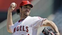 In this Sept. 27, 2012, file photo, Los Angeles Angels starter Dan Haren pitches to the Seattle Mariners in the second inning of a baseball game in Anaheim, Calif. (Associated Press)
