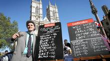A bookie takes bets related to the royal wedding outside Westminster Abbey on April 27, 2011 in London. (Chris Jackson/Chris Jackson/Getty Images)