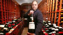 Grand Cru Culinary Wine Festival co-chair Todd Halpern and friend: a 3-litre bottle of 1971 La Tâche bound for auction. (Fernando Morales/The Globe and Mail)