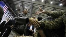 U.S. President Barack Obama shakes hands with troops after delivering remarks at Bagram Air Base in Kabul on May 25, 2014.
