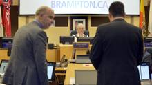 Brampton Mayor Susan Fennell questions two Deloitte auditors during a discussion on the report on her expenses at a city council meeting on Aug. 6. (J.P. Moczulski for The Globe and Mail)