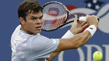 Milos Raonic, of Canada, returns a shot to Richard Gasquet, of France, during the fourth round of the 2013 U.S. Open tennis tournament, Monday, Sept. 2, 2013, in New York. (Mike Groll/AP)