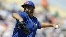 Toronto Blue Jays starting pitcher Ricky Romero throws during the first inning of a spring exhibition baseball game against the Detroit Tigers in Lakeland, Fla., Tuesday, March 18, 2014. (Carlos Osorio/AP)