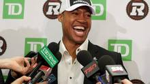 Henry Burris has a laugh with members of the media at a news conference in Ottawa, Tuesday, Feb.4, 2014, where the CFL's RedBlacks announced they had signed the veteran quarterback as a free agent. (Mike Carroccetto/THE CANADIAN PRESS)