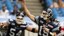 Toronto Argonauts quarterback Ricky Ray launches a pass during first half CFL action against the Calgary Stampeders in Toronto on Saturday July 7, 2012. (Frank Gunn/THE CANADIAN PRESS)
