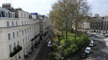 The grand terraces and lavish white houses of Wilton Crescent, north of Buckingham Palace, are popular with ambassadors and politicians. Super-rich newcomers to London are increasingly demanding hi-tech security systems. (OLIVIA HARRIS/Reuters)