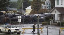 Crushed tanker cars can be seen near a residential area in Lac-Mégantic, Que., on July 9, 2013. (MOE DOIRON/THE GLOBE AND MAIL)