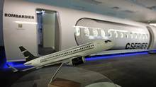 A scale model of a CS100 Bombardier airplane is displayed beside a mock-up of the future C Series Bombardier aircraft at the company's Montreal offices in 2009. Test flights, expected Monday, are part of a lengthy approval process and won't immediately determine how the jets would perform with Porter Airlines' controversial expansion plan at the Toronto Islands airport. (CHRISTINNE MUSCHI/REUTERS)
