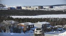 The Wabush Mines stands in the distance behind homes in Wabush, Labrador. (FRED LUM/THE GLOBE AND MAIL)