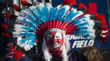 """Cleveland Indians fan Austin Howell waits for the gates as the Indians take on the Toronto Blue Jays during American League Championship Series baseball action in Cleveland on Friday, October 14, 2016. The Human Rights Tribunal of Ontario is set to hear a case today of a man who alleges indigenous names and symbols used by some Mississauga, Ont., hockey teams demonstrate institutional racism. Just last month, a judge quashed an activist's bid to prevent the Cleveland Indians from using its team name and """"Chief Wahoo"""" logo when playing in Toronto. (Nathan Denette/THE CANADIAN PRESS)"""