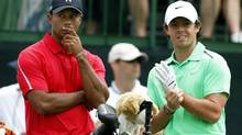Tiger Woods of the U.S. talks to Rory McIlroy of Northern Ireland on the tee of the 12th hole during the final round of the Memorial Tournament at Muirfield Village Golf Club in Dublin, Ohio in this file photo from June 2, 2013. McIlroy, who will face Woods in the upcoming Barclays tournament, feels it may be premature to write Woods off, despite his major title drought dating back to the 2008 U.S. Open. (Matt Sullivan/Reuters)