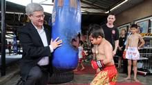 While the business crowd was fuming about shabby access to Steven Harper, the Prime Minister found time to visit a Thai boxing gymnasium. (Sean Kilpatrick/The Canadian Press/Sean Kilpatrick/The Canadian Press)