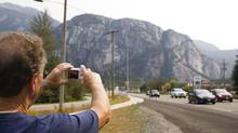 In a file photo, Len Noel, visiting B.C. from Bracebridge, Ont., stops along Highway 99 in Squamish to take a photograph of the Stawamus Chief on Monday, August 2, 2010. (Brian Thompson For The Globe and Mail)