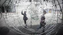 A store front window damaged during the Stanley Cup riot in Vancouver, seen here June 23, 2011. (John Lehmann/ The Globe and Mail/John Lehmann/ The Globe and Mail)