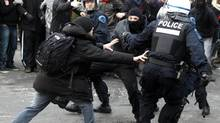 A protester is grabbed by the police as they demonstrate following the Summit of Higher Education in Montreal, February 26, 2013. (CHRISTINNE MUSCHI/REUTERS)