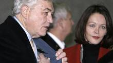 Conrad Black arrives with his wife Barbara Amiel at the Federal District Court in Chicago for sentencing, on Dec. 10, 2007. (M. Spencer Green/M. Spencer Green/The Associated Press)