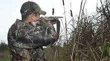 A duck hunter takes aim near Fenelon Falls, Ont., on Oct. 25, 2011. (FRED THORNHILL/Fred Thornhill for The Globe and Mail)