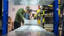Michael Cai works on an industrial grade battery for the marine industry on the assembly line at Corvus Energy in Richmond, B.C., on Thursday Oct. 20, 2016. (DARRYL DYCK For The Globe and Mail)