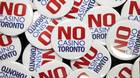 """""""No Casino Toronto"""" buttons were handed out by Maureen Lynett, Sheila Lynett, and Peggy Calvert, who are opposed to a casino, during a casino consultation and discussion event at Toronto City Hall on Wed., January 9, 2013."""