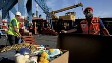 Israeli port workers prepare humanitarian aid seized from a peace flotilla to be sent to Gaza, at the Ashdod Port on June 1, 2010 in Ashdod, Israel. (Uriel Sinai/Getty Images)