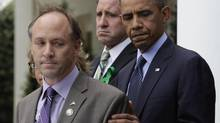 Mark Barden, the father of Newtown shooting victim Daniel, and Barack Obama, before their comments on the defeat of the gun-control bill in the REUTERS/Yuri Gripas (YURI GRIPAS/REUTERS)