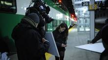 Canadian actor Tatiana Maslany, right, who plays Sarah Manning and the character's clones in Orphan Black, is the star of the TV series. But GO trains and other Toronto and area icons make frequent cameos. (Steve Wilkie/Bell Media)