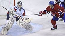 Montreal Canadiens' Jeff Halpern tries to deflect the puck past Washington Capitals goalie Braden Holtby during first period NHL hockey action Tuesday, March 15, 2011 in Montreal. (Paul Chiasson)