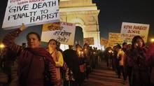 Women demand justice at a vigil in New Delhi Thursday after a young student was raped and left near death in the city Sunday. (Associated Press)