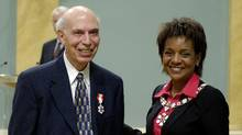 Ed Safarian is presented with the Member of the Order of Canada insignia by Michaëlle Jean, then governor-general, at Rideau Hall in November, 2005. (Cpl. Issa Paré, Rideau Hall)