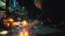 A man lights candles in front of Arena-2000, the home venue of the Russian ice hockey team Lokomotiv Yaroslav in Yaroslavl early on Sept. 8, 2011 after the team was involved in an air crash. (Alexander Nemenov/AFP/Getty Images/Alexander Nemenov/AFP/Getty Images)