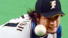 Japanese pitcher Yu Darvish of Nippon-Ham Fighters hurls the ball against Seibu Lions batters at a professional baseball game in Sapporo on October 29, 2011. Darvish announced his wish to play Major League Baseball on December 8, 2011, becoming the latest mega star aiming to cross the Pacific. Born to an Iranian father and a Japanese mother, Darvish is currently the highest-paid player in Japanese baseball, earning an estimated 500 million yen ($6.4 million) per season. Getty Images / JIJI PRESS (Jiji Press/Getty Images)