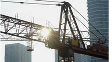Construction near Bremner Boulevard and York Street in Toronto. New technology and efficient design are allowing employers to occupy smaller spaces, a CRBE study finds. (Fred Lum/The Globe and Mail)