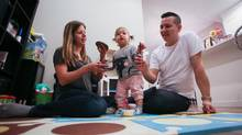 Mike Neudorf and his wife Melissa Neudorf are pictured in their townhouse with their 15-month-old daughter, Chloe in Surrey, British Columbia on February 2, 2017. (Ben Nelms/The Globe and Mail)