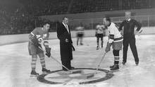 "Before a capacity crowd in Maple Leaf Gardens, the Leafs defeated the All-Stars by 7 to 3 in a game played for the benefit of injured hockey player, Irvin ""Ace"" Bailey. Ace Bailey starts the game with a face-off between Joe Primeau of Toronto Maple Leafs and Howie Morenz of NHL All-Stars. Leafs defeated All-Stars 7-3 before a crowd of over 14,000 at Maple Leaf Gardens. (John Boyd/The Globe and Mail)"