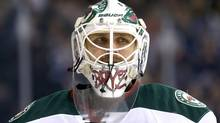 Minnesota Wild's Ilya Bryzgalov takes a breather during a commercial break while playing against the Winnipeg Jets during second period NHL hockey action in Winnipeg, Monday, April 7, 2014. (The Canadian Press)