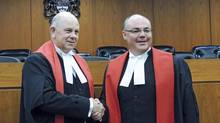 Associate Chief Justice John Rooke, left, congratulates Justice Russell Brown on being sworn in as a judge on the Alberta Court of Queen's Bench in 2013. (File Photo) (University of Alberta)