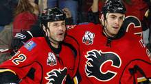 Calgary Flames' Daymond Langkow, left, celebrates his goal with teammate Eric Nystrom during second period NHL hockey action against the Phoenix Coyotes in Calgary, Wednesday, Nov. 25, 2009. Langkow returned to the Calgary lineup on Friday after missing more than a year with a broken neck. THE CANADIAN PRESS/Jeff McIntosh (Jeff McIntosh/THE CANADIAN PRESS)