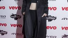 New Zealand singer-songwriter Lorde arrives on the red carpet for the Vevo Halloween Concert at the Oval Space in east London, Thursday, Oct. 31, 2013 (Joel Ryan/AP)