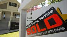 A sold sign is pictured outside a home in Vancouver, B.C., Tuesday, June, 28, 2016. A Globe and Mail investigation revealed possible tax evasion and fraud in Metro Vancouver's housing market. (JONATHAN HAYWARD/THE CANADIAN PRESS)