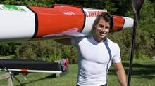 Canadian Olympic kayaker Adam van Koeverden carries a kayak at the Burloak Canoe Club in Oakville, Ont. on Wednesday, June 13, 2012. (Aaron Vincent Elkaim/THE CANADIAN PRESS)
