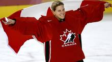Canada's Kim St-Pierre skates around the ice drapped in the Canadian flag following her team's 4-1 victory over Team Sweden to win the gold medal in womens hockey at the Turin 2006 Winter Olympic Games Monday, Feb. 20, 2006 in Turin. (The Canadian Press)