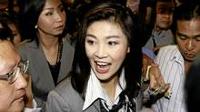 Yingluck Shinawatra, the leader of Pheu Thai Party, talks with reporters upon her arrival at a hotel for a meeting with leaders of the coalition partners on Monday, July 4, 2011 in Bangkok. (Apichart Weerawong/AP/Apichart Weerawong/AP)