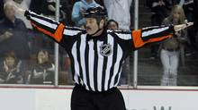 Referee Francois St. Laurent signals no goal on an overtime shootout shot . (ALEX GALLARDO/Reuters)